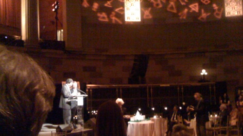 An iPhone image of Dan Brown (right) and editor Jason Kaufman speaking at The Lost Symbol book lanch party, Gotham Hall, New York. (Photo by LA Times reporter Carolyn Kellogg.)